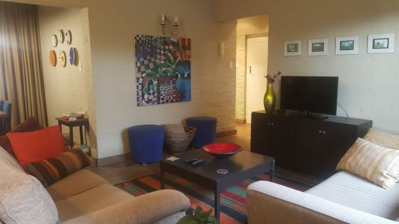 Warm and cosy apartment lounge in self-catering accommodation near Rosebank | Acorns on 8th