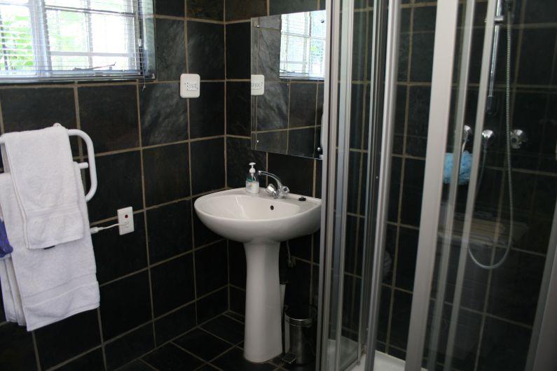 Bathroom in self-catering garden cottage near Rosebank
