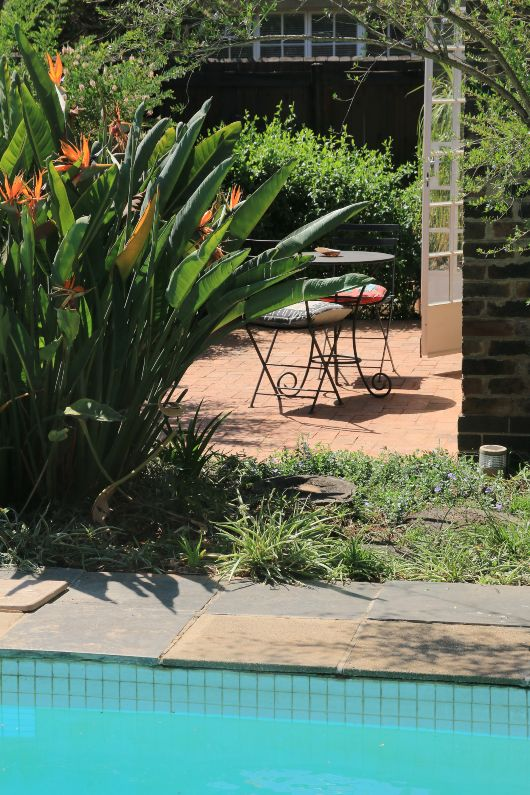 Self-catering garden cottage and swimming pool